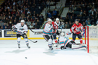 KELOWNA, CANADA - FEBRUARY 2: Rourke Chartier #14 and Gordie Ballhorn #4 of Kelowna Rockets look for the rebound against the Lethbridge Hurricanes on February 2, 2016 at Prospera Place in Kelowna, British Columbia, Canada.  (Photo by Marissa Baecker/Shoot the Breeze)  *** Local Caption *** Gordie Ballhorn; Rourke Chartier; Michael Herringer;