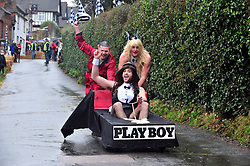 &copy; Licensed to London News Pictures.01/01/2018<br /> SUTTON VALENCE, UK.<br /> PLAYBOY TEAMING WINNING.<br /> The traditional New Years day Sutton Valence Pram Race in Kent continued this year. In its 38th year the Race was struck by tragedy last year when competitor Francis 'Titch' O' Sullivan tipped over in his spitfire pram and hit his head on the curb, he passed away a day later. A coroners court reported he was not wearing a helmet.<br />  All babies in the pram's have to wear a helmet and the pushers must have contact with the pram and the ground at all times.<br />  <br /> Photo credit: Grant Falvey/LNP