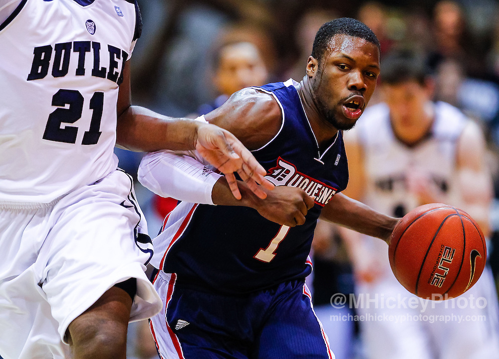 INDIANAPOLIS, IN - FEBRUARY 19: Derrick Colter #1 of the Duquesne Dukes brings the ball up court during the game against the Butler Bulldogs at Hinkle Fieldhouse on February 19, 2013 in Indianapolis, Indiana. Butler defeated Duquesne 68-49. (Photo by Michael Hickey/Getty Images) *** Local Caption *** Derrick Colter