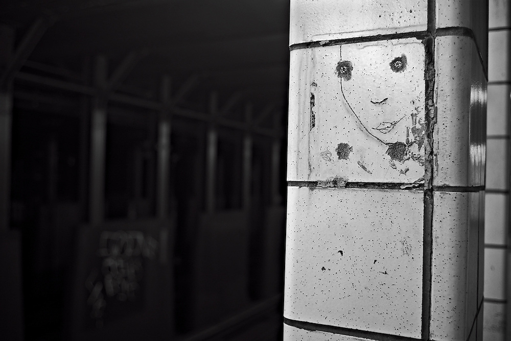 Face drawn on column on subway platform, 45th St Brooklyn, New York, NY, US