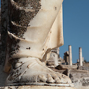 Foot of a statue showing traditional sandal on Curetes Street, Ephesus, Izmir, Turkey. Curetes Street was one of 3 main streets in Ephesus, leading from the Hercules Gate to the Celsus Library. It was a paved road lined with statues. Ephesus was an ancient Greek city founded in the 10th century BC, and later a major Roman city, on the Ionian coast near present day Selcuk. Picture by Manuel Cohen