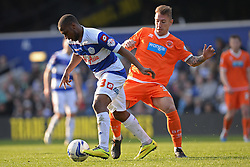 QPR's forward David Hoilett and Blackpool's defender Jack Robinson  - Photo mandatory by-line: Mitchell Gunn/JMP - Tel: Mobile: 07966 386802 29/03/2014 - SPORT - FOOTBALL - Loftus Road - London - Queens Park Rangers v Blackpool - Championship