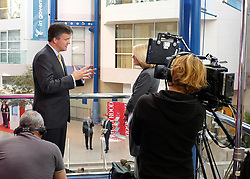 © Licensed to London News Pictures. 21/09/2011. BIRMINGHAM, UK.    Michael Moore Secretary of State for Scotland being interviewed on television at the Liberal Democrat Conference at the Birmingham ICC today (21 Sept 2011): Stephen Simpson/LNP . Photo credit : Stephen Simpson/LNP