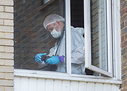 © Licensed to London News Pictures. 26/05/2018. Crawley, UK. Police forensics officers work in a block of flats in Crawley where a woman was found dead.  A man has been arrested on suspicion of murder after the woman was found in her bed. Police are appealing for witnesses to come forward.  Photo credit: Peter Macdiarmid/LNP