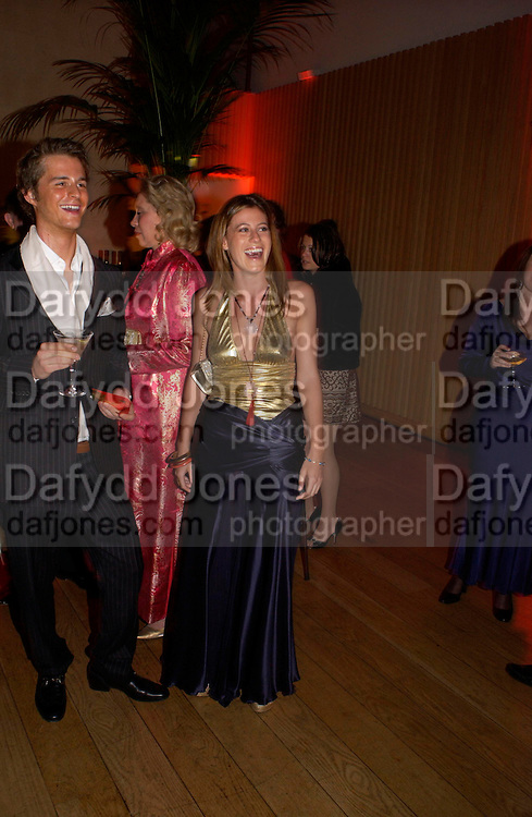 Francesca Versace and Philip Schuler.  Andy & Patti Wong's Chinese New Year party to celebrate the year of the Rooster held at the Great Eastern Hotel, Liverpool Street, London.29th January 2005. The theme was a night of hedonism in 1920's Shanghai. . ONE TIME USE ONLY - DO NOT ARCHIVE  © Copyright Photograph by Dafydd Jones 66 Stockwell Park Rd. London SW9 0DA Tel 020 7733 0108 www.dafjones.com