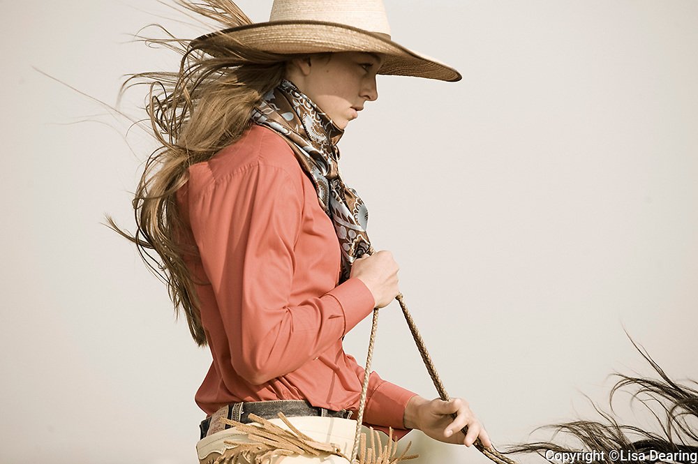 Cowgirl with Buckaroo Hat Riding Horse in Idaho