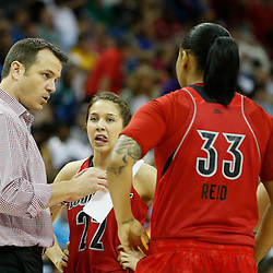 Apr 9, 2013; New Orleans, LA, USA; Louisville Cardinals head coach Jeff Walz (left) instructs his team against the Connecticut Huskies during the second half of the championship game in the 2013 NCAA womens Final Four at the New Orleans Arena. Mandatory Credit: Derick E. Hingle-USA TODAY Sports