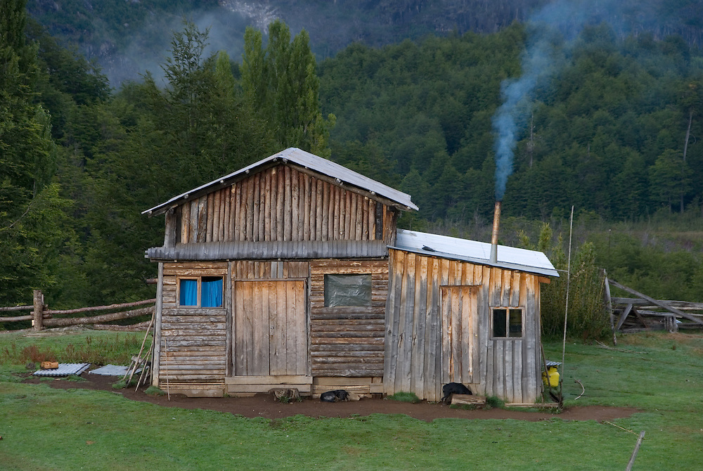 Rustic log farm house in Chile's Futaleufu River Valley.