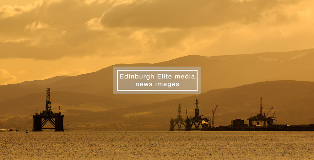 Oil rigs at sunset stand off the village of Invergordon in the Cromarty Firth, Scotland<br /> <br /> (c) Andrew Wilson   Edinburgh Elite media