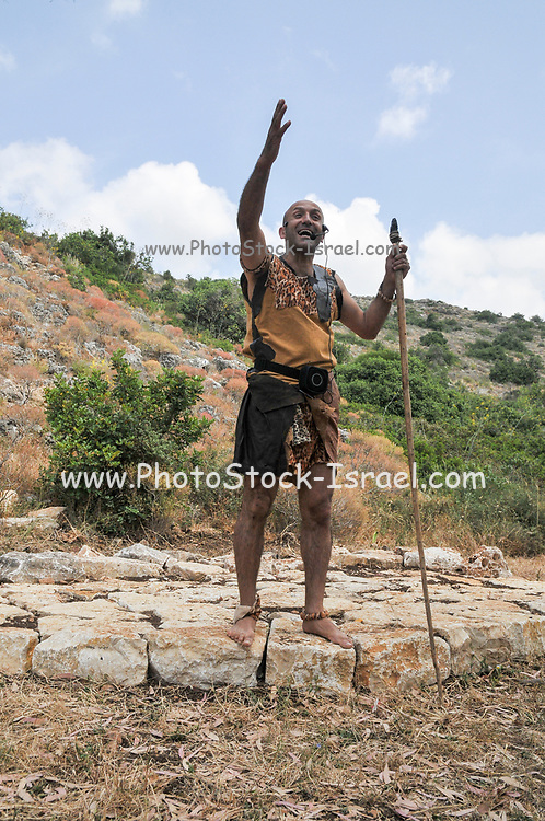 Actor portrays a caveman at the of the prehistoric cave at Carmel mountain Caves