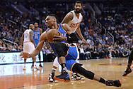Feb 8, 2016; Phoenix, AZ, USA; Oklahoma City Thunder guard Russell Westbrook (0) trips after being fouled by Phoenix Suns forward P.J. Tucker (not pictured) at Talking Stick Resort Arena.  The Oklahoma City Thunder won 122- 106.  Mandatory Credit: Jennifer Stewart-USA TODAY Sports