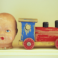 Doll head and toy train
