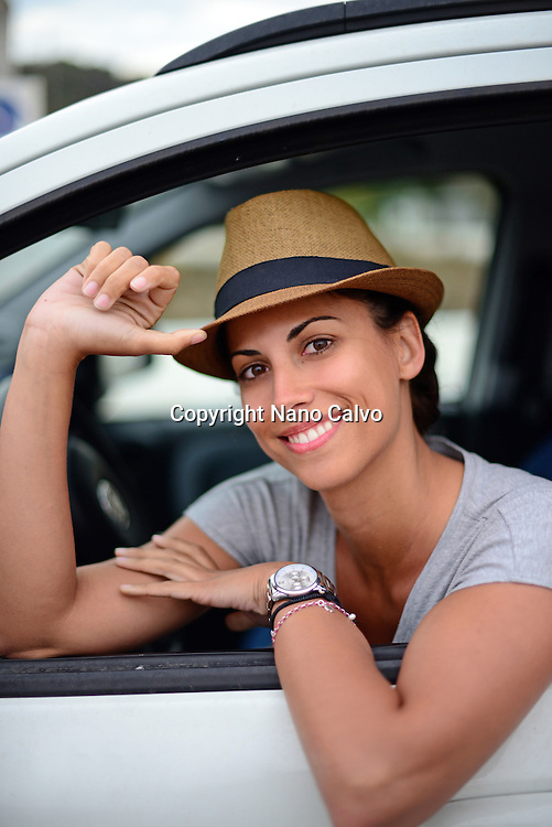 Attractive young woman in car, Ibiza, Balearic Islands, Spain