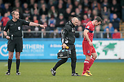 C. Boyeson (Referee) points to where a free kick will be taken, having allowed Luke Joyce (Carlisle United) to receive treatment. The referee had, at first, refused to allow the Carlisle United player to receive treatment on the pitch and had ordered him to go to the sideline during the EFL Sky Bet League 2 match between Hartlepool United and Carlisle United at Victoria Park, Hartlepool, England on 14 April 2017. Photo by Mark P Doherty.