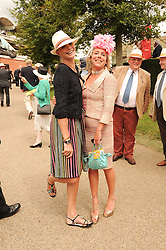 Left to right, JODIE KIDD and COZMO JENKS at the third day of the 2010 Glorious Goodwood racing festival at Goodwood Racecourse, Chichester, West Sussex on 29th July 2010.