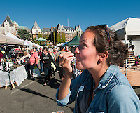 Taylor enjoys a taste of fudge at the Ship Point market on the Inner Harbour of Victoria, BC