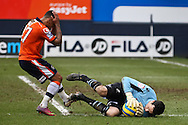 Picture by David Horn/Focus Images Ltd +44 7545 970036.16/02/2013.Andre Gray of Luton Town is denied a scoring opportunity by David Forde of Millwall during the The FA Cup match at Kenilworth Road, Luton.