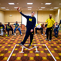 BLOOMINGTON, IN -- February 3, 2013 -- University of Michigan's Nik Stauskas walks through plays with assistant coach LaVall Jordan in a hotel conference room taped off like a court before taking on the Indiana University Hoosiers. (PHOTO / CHIP LITHERLAND)