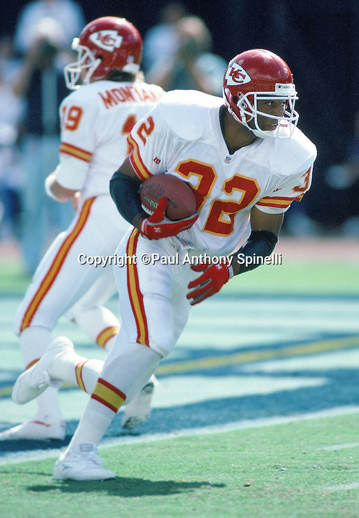 Kansas City Chiefs running back Marcus Allen (32) runs the ball after a handoff from Kansas City Chiefs quarterback Joe Montana (16) during the NFL football game against the San Diego Chargers on Oct. 17, 1993 in San Diego. The Chiefs won the game 17-14. (©Paul Anthony Spinelli)