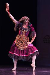 © Licensed to London News Pictures. 18/09/2015. London, UK. Varvara Bractchikova (Giovanni Goffredo) as Gypsy. Les Ballets Trockadero de Monte Carlo (The Trocks) perform the UK premiere of Don Quixote during a photocall at the Peacock Theatre. With Yakaterina Verbosovich (Chase Johnsey) as Kitri, PVyacheslav Legupski (Paolo Cervellera) as Basil, Olga Supphozova (Robert Carter) as Amour, Lariska Dumbcheno (Raffaele Morra) as Mother, Boris Nowitsky (Carlos Renedo) as Count and Varvara Bractchikova (Giovanni Goffredo) and Eugenia Repelskii (Joshua Thake) as Gypsies. Photo credit: Bettina Strenske/LNP