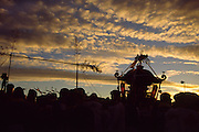 A mikoshi and supporters seen in silhouette during the Hamaorisai Matsuri that takes place on Southern Beach in Chigasaki near Tokyo, Kanagawa, Japan Monday July17th  2006. The festivals marks the celebration of Marine Day in July. Over forty Mikoshi or portable shrines are carried through the night from surrounding shrines to arrive on the beach for sunrise. They are then carried into the surf to purify them.