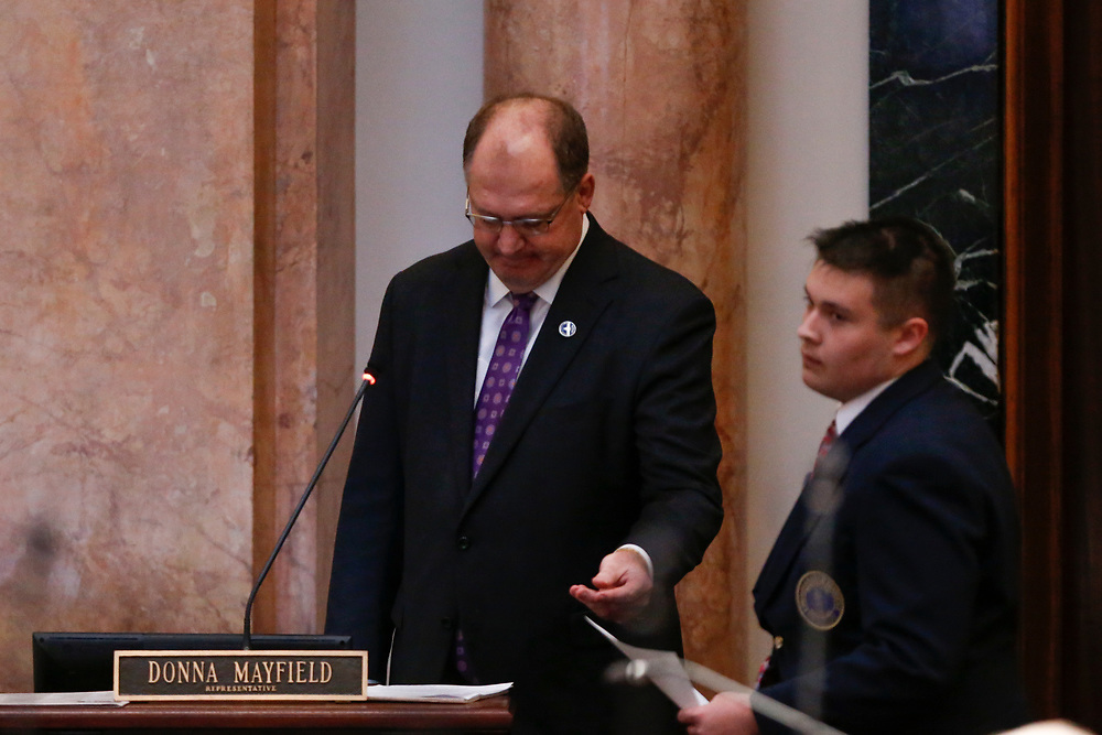 Speaker of the House Rep. Jeff Hoover, R-Russell, hands his resignation letter from the Speaker of the House to a page in a floor speech during the General Assembly in the State Capitol in Frankfort, Ky., Monday, January 8, 2018.