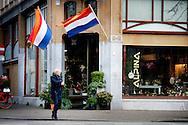 THE HAGUE - The flags, with orange streamer, now go out on December 7, the anniversary of Princess Catharina-Amalia has become 12 years today . de vlaggen hangen uit voor de 12 jarige prinses Amalia in den haag  met oranje wimpel Prinses Amalia is vandaag 12 jaar geworden.  Wat de prinses gaat doen vandaag om haar verjaardag te vieren is niet bekend . copyright robin utrecht
