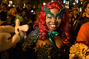 New York, NY, October 31, 2013. A smiling woman wearing a costume of leaves, red berries, and a red wig in New York's Greenwich Village Halloween Parade.