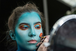© Licensed to London News Pictures. 18/05/2019. LONDON, UK. A make-up artist at work at the International Make-Up Artists Trade Show (IMATS) taking place at Kensington Olympia 16 to 19 May 2019.  The show brings together make-up artists from around the world, including those with Hollywood movie backgrounds, providing classes in theatre, film, TV, fashion and editorial make-up to professionals and enthusiasts.  Photo credit: Stephen Chung/LNP
