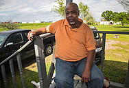 Keith Hunter at his home in St. James Parish, next to an oil tank farm. If built, the Bayou Bridge Pipeline will end near his home.