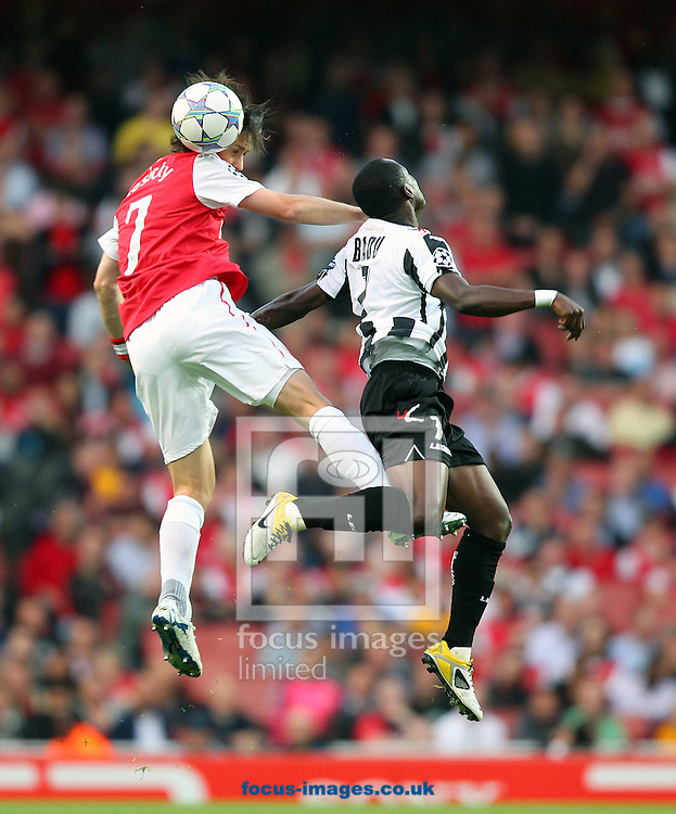 Picture by James Ward/Focus Images Ltd.  07908 205049.16/8/11.Tomas Rosicky of Arsenal wins the ball in the air despite the attentions of Emmanuel Agyemang-Badu of Udinese during the UEFA Champions League qualifying play off, 1st leg, at the Emirates Stadium, London.