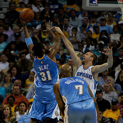 27 April 2009: Denver Nuggets center Nene' (31) shoots over New Orleans Hornets forward Sean Marks (4) during game four of the NBA Western Conference Quarterfinals playoffs between the New Orleans Hornets and the Denver Nuggets at the New Orleans Arena in New Orleans, Louisiana.