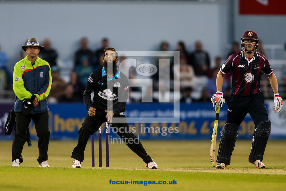 Moeen Ali of Worcestershire Rapids (centre) and Alex Wakely of Northants Steelbacks look skywards during the Natwest T20 Blast match at the County Ground, Northampton<br /> Picture by Andy Kearns/Focus Images Ltd 0781 864 4264<br /> 05/06/2015