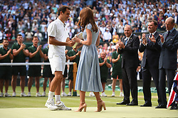 Serbian Novak Djokovic receives the winners trophy from the Duchess of Cambridge after victory in the Men's Singles Final match against Swiss Roger Federer at Wimbledon on Sunday, July 14, 2019. Djokovic won the match 7-6,1-6,7-6,4-6,13-12. Photo by ABACAPRESS.COM