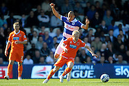 Blackpool's David Perkins breaks away from Queens Park Rangers Bobby Zamora . Skybet football league championship match , Queens Park Rangers v Blackpool at Loftus Road in London  on Saturday 29th March 2014.<br /> pic by John Fletcher, Andrew Orchard sports photography.