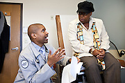 Dr. Tony Hampton, with Advocate Health, talks with Bertha Smith, 68, about her medical condition during a visit at the Beverly Medical Building in Chicago on Tuesday, November 12, 2013. Nathan Weber for ProPublica