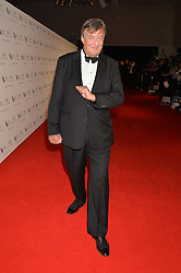 STEPHEN FRY at the IWC Schaffhausen Gala Dinner in honour of the British Film Institute held at the Battersea Evolution, Battersea Park, London on 7th October 2014.