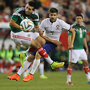 Miguel Veloso, Portugal, shoots past Héctor Herrera, Mexico, during the Portugal V Mexico International Friendly match in preparation for the 2014 FIFA World Cup in Brazil. Gillette Stadium, Boston (Foxborough), Massachusetts, USA. 6th June 2014. Photo Tim Clayton
