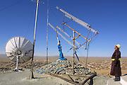 GOBI DESERT, MONGOLIA..09/03/2001.Bayanhongor (Bayankhongor). Ovoo (stone heap to honour local patron gods), telecommunication equipment on stupa hill..(Photo by Heimo Aga).