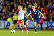Rachel Corsie (#4) of Scotland commits the foul by grabbing the hand of Lara Dickenmann (#11) of Switzerland during the 2019 FIFA Women's World Cup UEFA Qualifier match between Scotland Women and Switzerland at the Simple Digital Arena, St Mirren, Scotland on 30 August 2018.