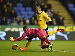 Reading's Adam Federici dives to deflect an attempt by Wigan Athletic's Leon Clarke - Photo mandatory by-line: Paul Knight/JMP - Mobile: 07966 386802 - 17/02/2015 - SPORT - Football - Reading - Madejski Stadium - Reading v Wigan Athletic - Sky Bet Championship