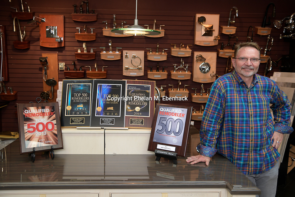 Keith Vellequette, owner and lead designer of KBF Design Gallery, stands among his awards in the showroom Monday, Sept. 18, 2017, in Altamonte Springs, Fla. (Photo by Phelan M. Ebenhack)