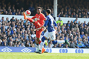 Liverpool striker Daniel Sturridge controls the ball watched by Everton defender Ramiro Funes Mori during the Barclays Premier League match between Everton and Liverpool at Goodison Park, Liverpool, England on 4 October 2015. Photo by Alan Franklin.