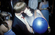Glamorgan University Ball in Treforest, Wales, May 1998. Photograph © Rob Watkins. Pictured: Couple kiss with party balloon