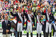 Podium Landenwedstrijd 1. Duitsland, 2. Engeland, 3. Nederland<br /> Alltech FEI World Equestrian Games™ 2014 - Normandy, France.<br /> © DigiShots