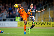 Dundee United defender William Edjenguele (#14) clears the ball under pressure from Dundee forward Faissal El Bakhtaoui (#20) during the Betfred Scottish Cup match between Dundee and Dundee United at Dens Park, Dundee, Scotland on 9 August 2017. Photo by Craig Doyle.