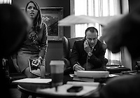WASHINGTON, DC - SEPTEMBER 24:  Senator Mike Lee (R-UT) works with his staff, Wendy Baig, left, furiously on the Continuing Resolution battle in the Senate before meeting with partner Senator Ted Cruz on Capitol Hill Tuesday September 24, 2013. (Photo by Melina Mara/The Washington Post)