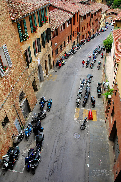 Street at Siena filled with scooters