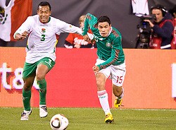 February 24, 2010; San Francisco, CA, USA;  Mexico forward Pablo Berrera (15) and Bolivia defender Edemir Rodriguez (3) battle for possession during the first half at Candlestick Park. Mexico defeated Bolivia 5-0.