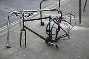 Bicycle stripped on wheels and saddle, London